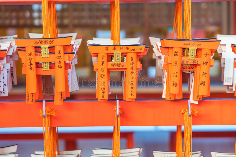KYOTO, JAPAN - Nov 23, 2016 : Ema prayer tables with unique Torii gates boards at Fushimi Inari Taisha Temple in Kyoto. Pray for luck, wealth, happiness royalty free stock photos