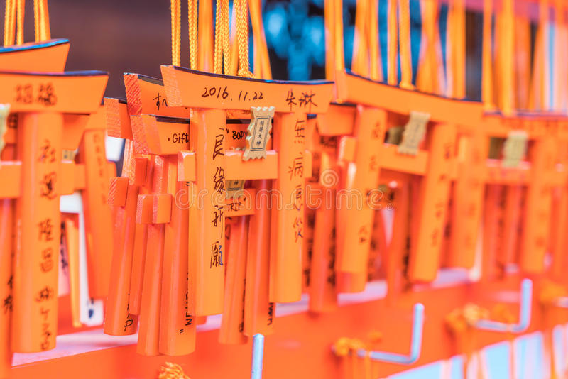 KYOTO, JAPAN - Nov 23, 2016 : Ema prayer tables with unique Torii gates boards at Fushimi Inari Taisha Temple in Kyoto. Pray for luck, wealth, happiness royalty free stock image