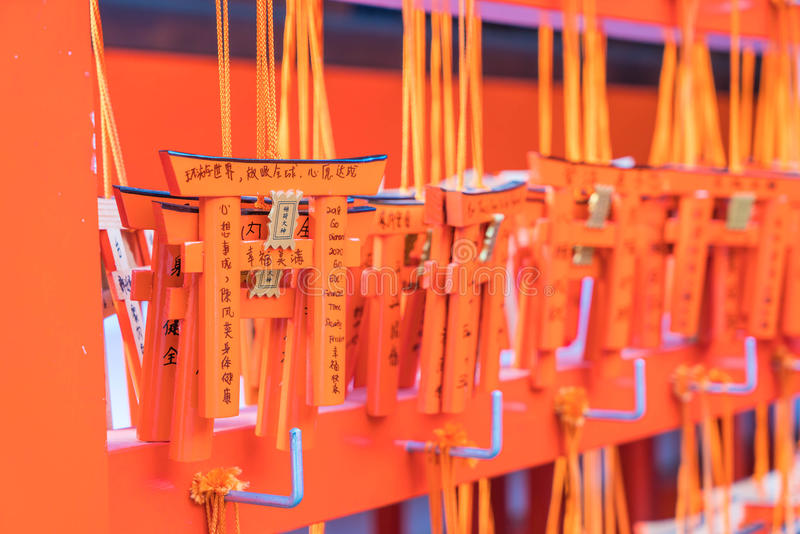 KYOTO, JAPAN - Nov 23, 2016 : Ema prayer tables with unique Torii gates boards at Fushimi Inari Taisha Temple in Kyoto. Pray for luck, wealth, happiness stock photography