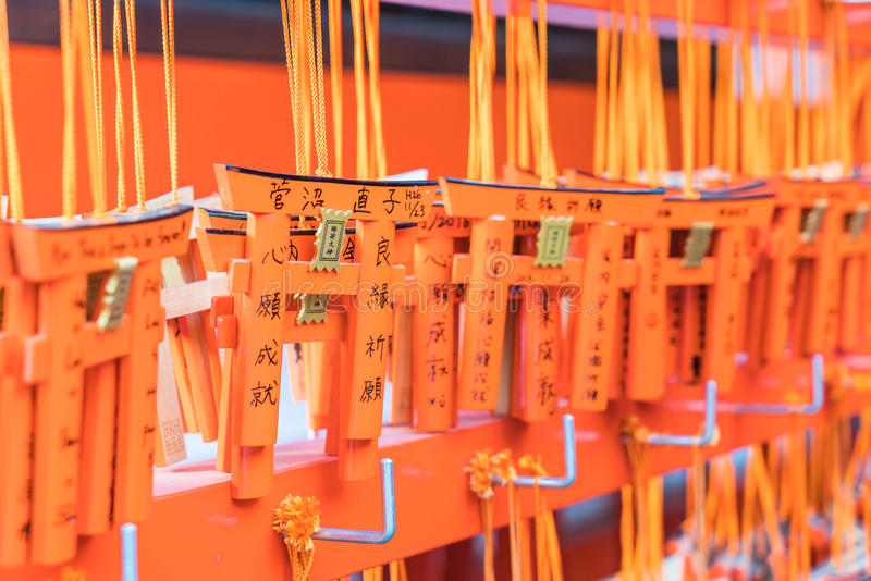 KYOTO, JAPAN - Nov 23, 2016 : Ema prayer tables with unique Torii gates boards at Fushimi Inari Taisha Temple in Kyoto. Pray for luck, wealth, happiness royalty free stock images