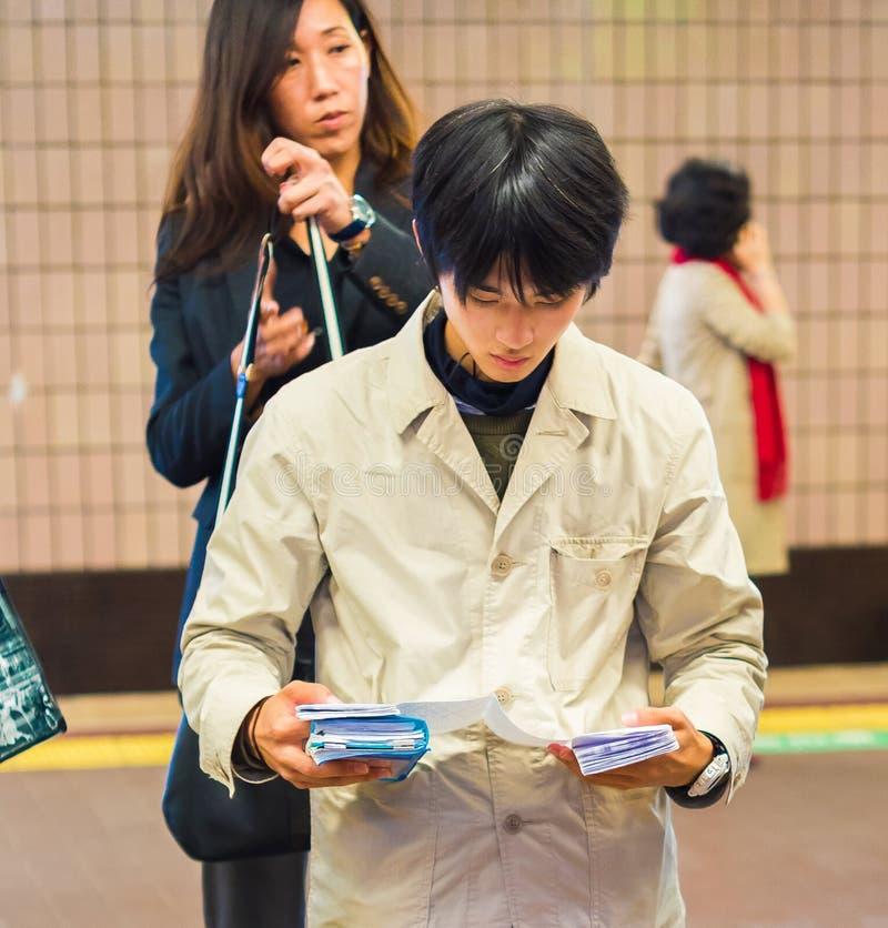 Free KYOTO, JAPAN - NOVEMBER 7, 2017: Japanese Man On The Subway Read Stock Photography - 117758612