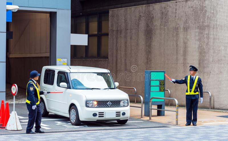 KYOTO, JAPAN - NOVEMBER 7, 2017: The car leaves the city parking lot. Copy space for text. royalty free stock photos