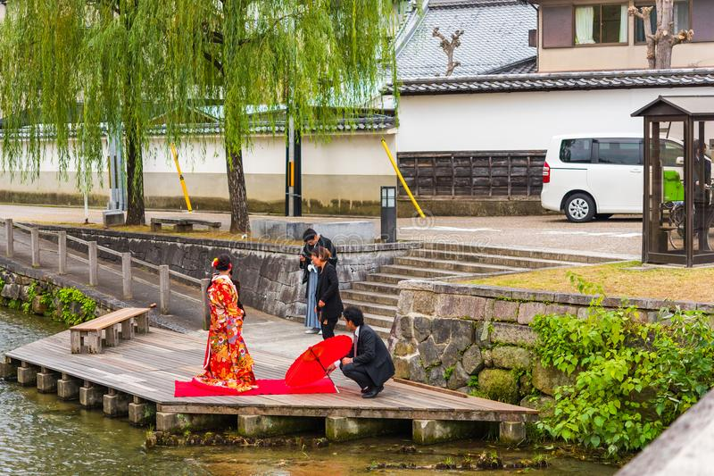 KYOTO, JAPAN - NOVEMBER 7, 2017: Couple in a kimono on the river bank. Copy space for text. KYOTO, JAPAN - NOVEMBER 7, 2017: Couple in a kimono on the river royalty free stock photo