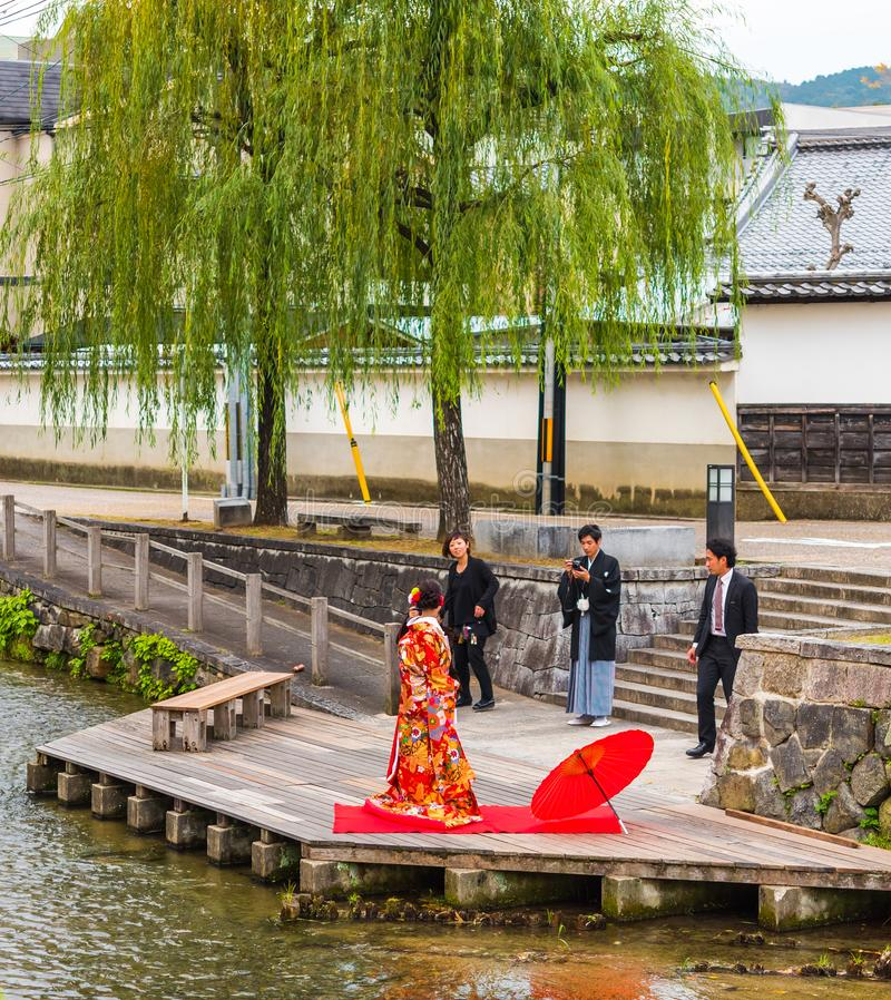 KYOTO, JAPAN - NOVEMBER 7, 2017: Couple in a kimono on the river bank. Copy space for text. KYOTO, JAPAN - NOVEMBER 7, 2017: Couple in a kimono on the river stock photography