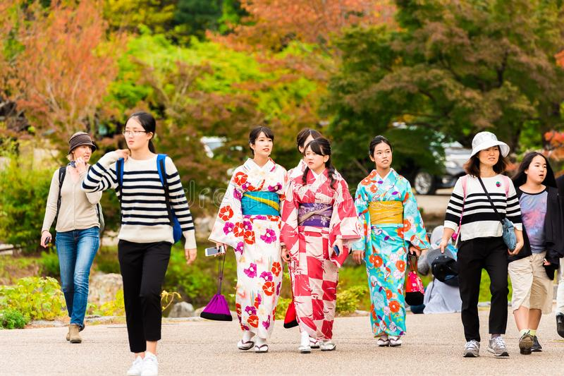 KYOTO, JAPAN - NOVEMBER 7, 2017: Group of girls in a kimono on a city street. Copy space for text. KYOTO, JAPAN - NOVEMBER 7, 2017: Group of girls in a kimono royalty free stock photography