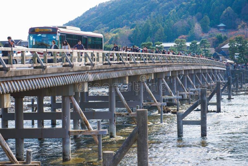 Kyoto, Japan - November 17, 2017 :Many tourists wallking on Togetsukyo bridge to cross Hozu-gawa river during autumn season in Ar stock image