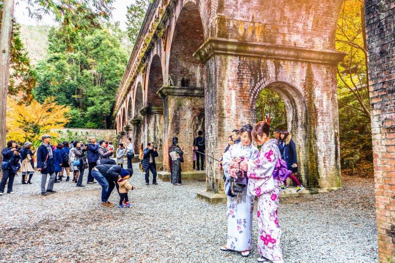 KYOTO, JAPAN - November 29, 2015 : Tourists dress Kimono visit N stock image