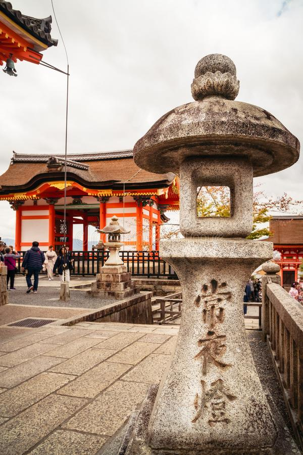 World heritage  buildings and stone lanterns at Kiyomizu-dera buddhist temple in Kyoto. royalty free stock photography