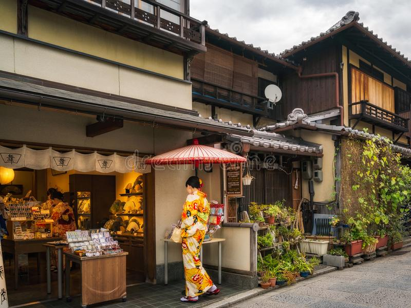 Ladies in traditional Japanese costume shopping in Gion. Kyoto. royalty free stock image
