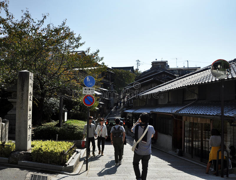 KYOTO, JAPAN - OCT 21 2012: Tourists walk on a street leading to