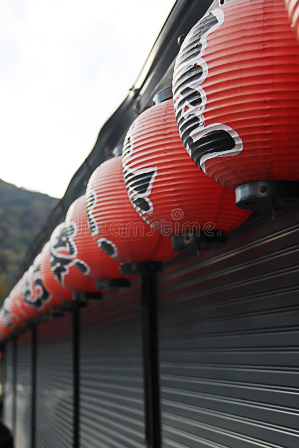 Kyoto, Japan - 2010: Paper red lantern, Chochin, hanging outside shop royalty free stock images