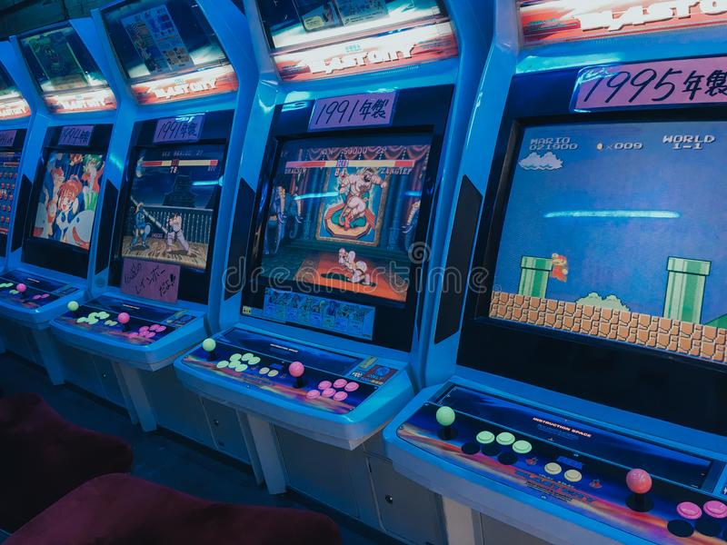 KYOTO, JAPAN, SEPTEMBER 14, 2017:Many retro classic 90`s famous game machines that standing in the vintage game shop, ready to stock photography