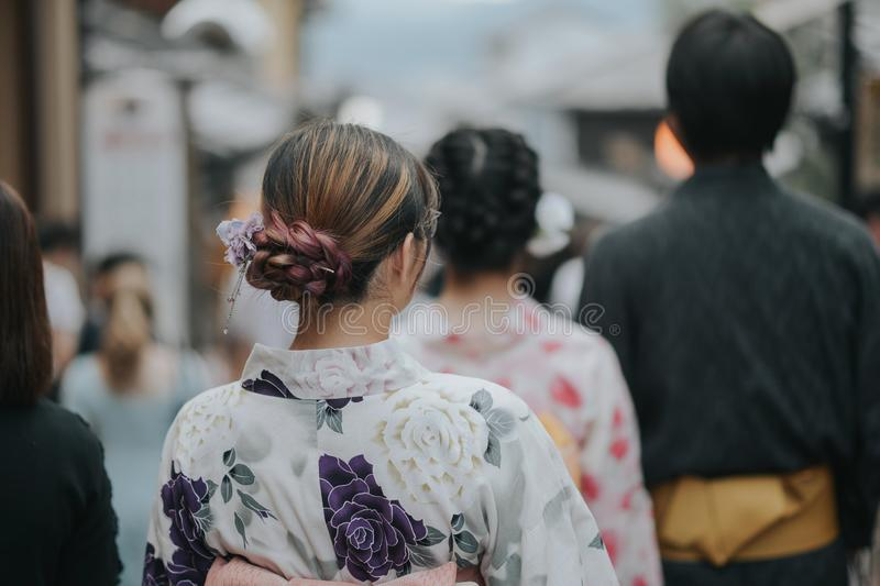 KYOTO, JAPAN, SEPTEMBER 14, 2017: young pretty girl wearing a traditional kimono walking in a kyoto street royalty free stock photos