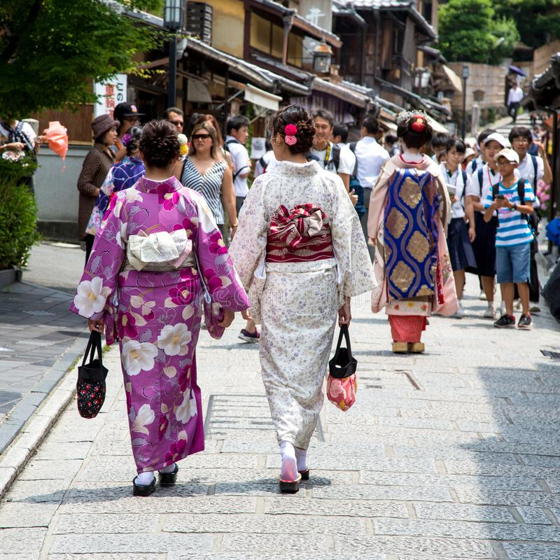 Geisha and tourists in the streets of Kyoto royalty free stock images