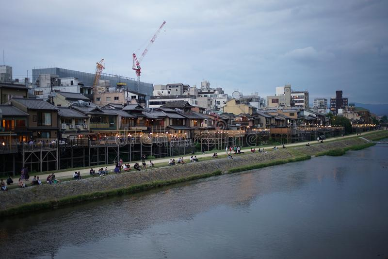 Kyoto Kamogawa Nouryou-Yuka, open-air seating by the Kamo River viewed from Shijo bridge in the ev royalty free stock images