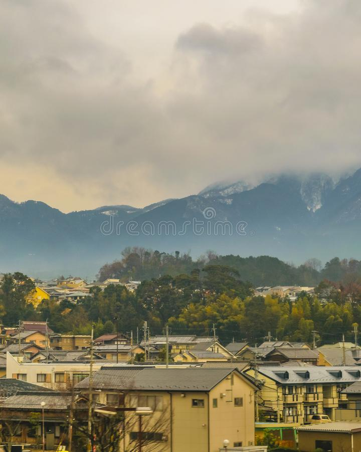 Kyoto Prefecture Cityscape, Japan. KYOTO, JAPAN, JANUARY - 2019 - Kyoto prefecture winter landscape scene from window train point of view royalty free stock image