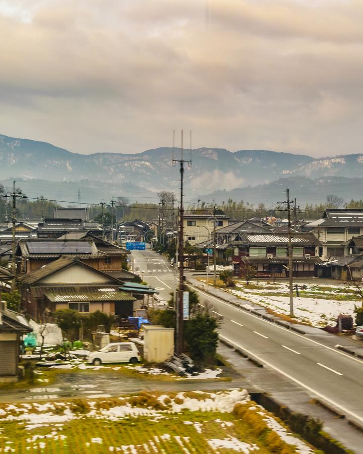 Kyoto Prefecture Cityscape, Japan. KYOTO, JAPAN, JANUARY - 2019 - Kyoto prefecture winter village cityscape scene from window train point of view royalty free stock images