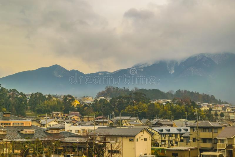 Kyoto Prefecture Cityscape, Japan. KYOTO, JAPAN, JANUARY - 2019 - Kyoto prefecture winter landscape scene from window train point of view royalty free stock photography
