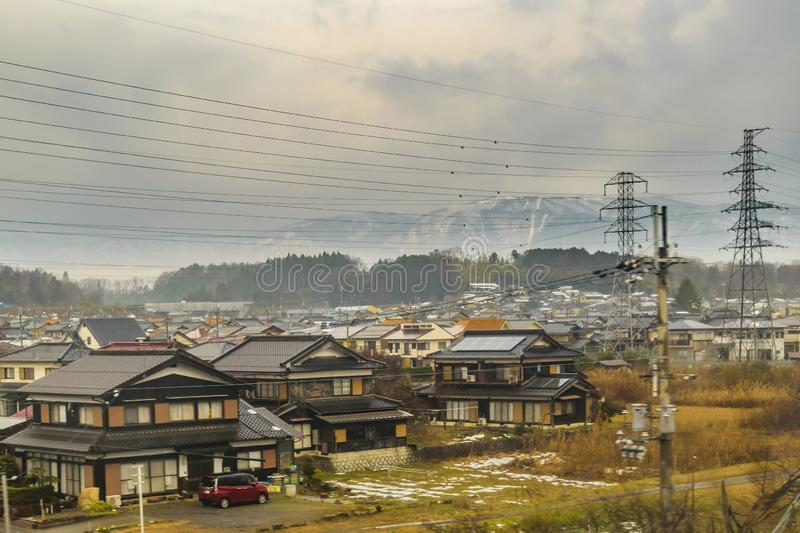 Kyoto Prefecture Cityscape, Japan. KYOTO, JAPAN, JANUARY - 2019 - Kyoto prefecture winter village cityscape scene from window train point of view royalty free stock photo
