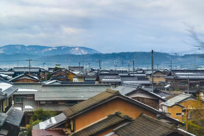 Kyoto Prefecture Cityscape, Japan. KYOTO, JAPAN, JANUARY - 2019 - Kyoto prefecture winter village cityscape scene from window train point of view stock images