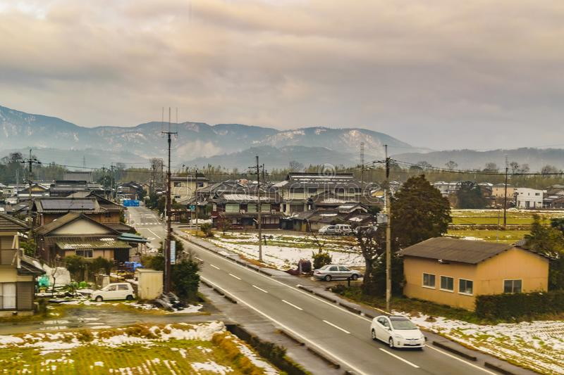 Kyoto Prefecture Cityscape, Japan. KYOTO, JAPAN, JANUARY - 2019 - Kyoto prefecture winter village cityscape scene from window train point of view stock photography