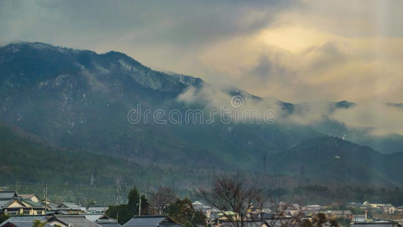 Kyoto Prefecture Lanscape, Japan. KYOTO, JAPAN, JANUARY - 2019 - Kyoto prefecture winter landscape scene from window train point of view stock photos