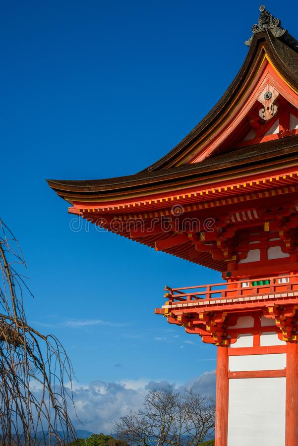 Kyoto temple and winter sky. Weather in Kyoto. Ancient temple with autumn or winter blue sky adn bare branch trees stock images