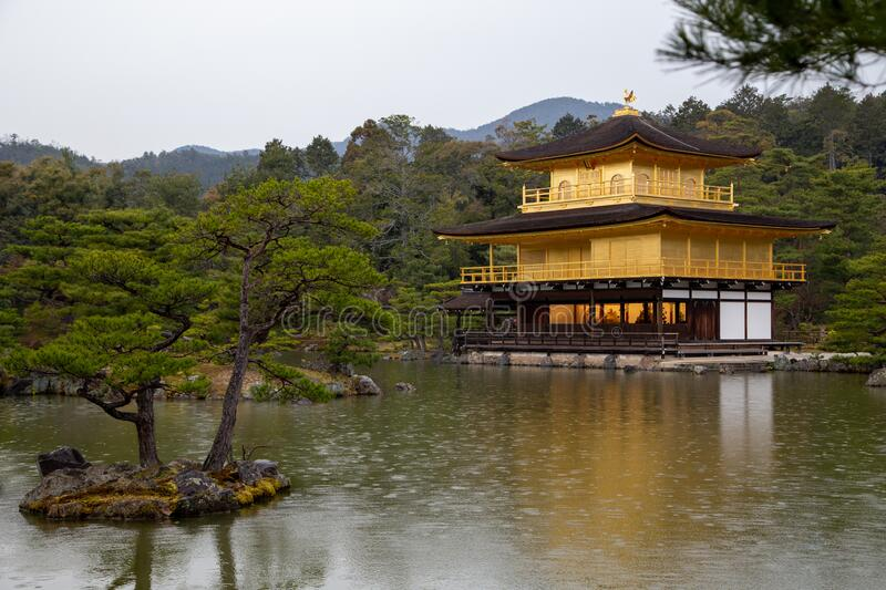 Kyoto Travel: Kinkakuji Golden Pavilion on a rainy day royalty free stock photo