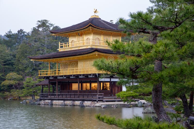 Kyoto Travel: Kinkakuji Golden Pavilion on a rainy day stock photos
