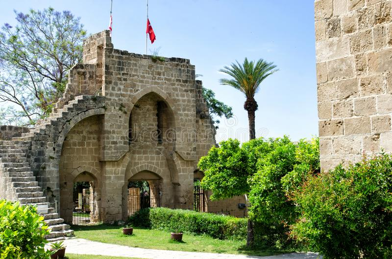 KYRENIA, CYPRUS - May 14, 2014: Ruins of the Abbey of Bellapais in the Northern Cyprus. Bellapais Abbey is the ruin of a royalty free stock photography
