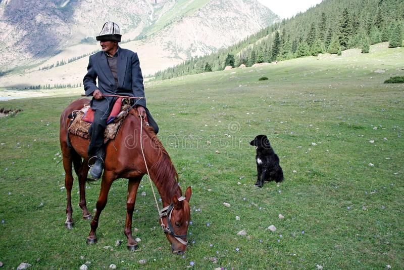 Kyrgyz horseman in Tien Shan mountains. Central tien shan region, Dzhuku valley stock images