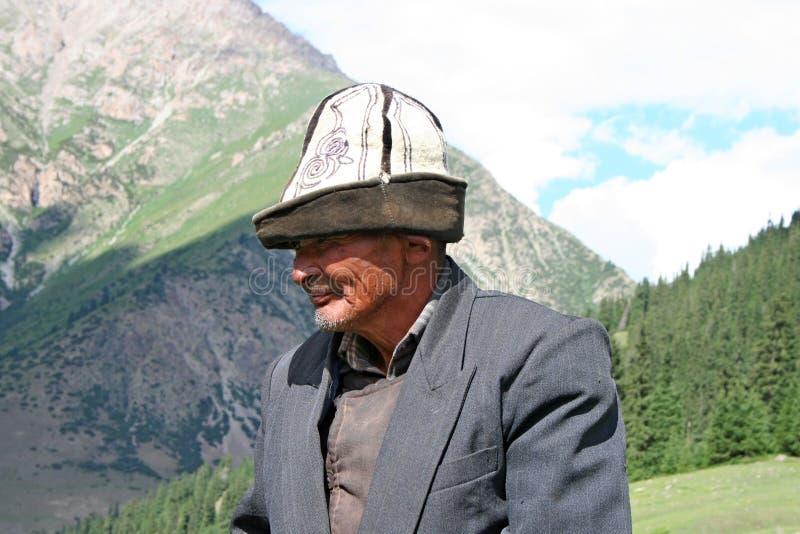 Kyrgyz horseman in Tien Shan mountains. Central tien shan region, Dzhuku valley royalty free stock photo