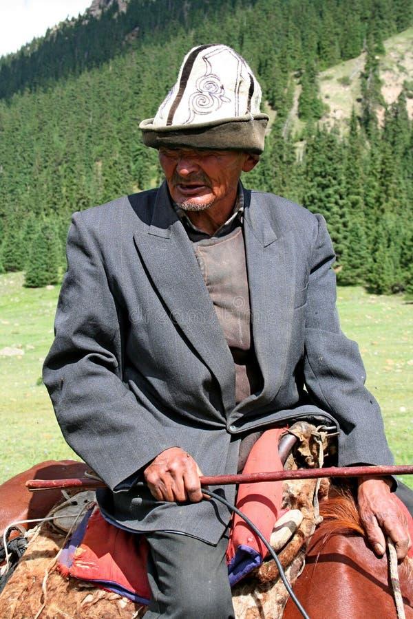 Kyrgyz horseman in Tien Shan mountains. Central tien shan region, Dzhuku valley stock image
