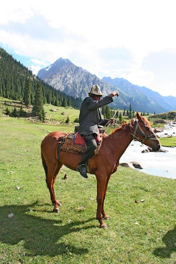 Kyrgyz horseman in Tien Shan mountains. Central tien shan region, Dzhuku valley stock photography