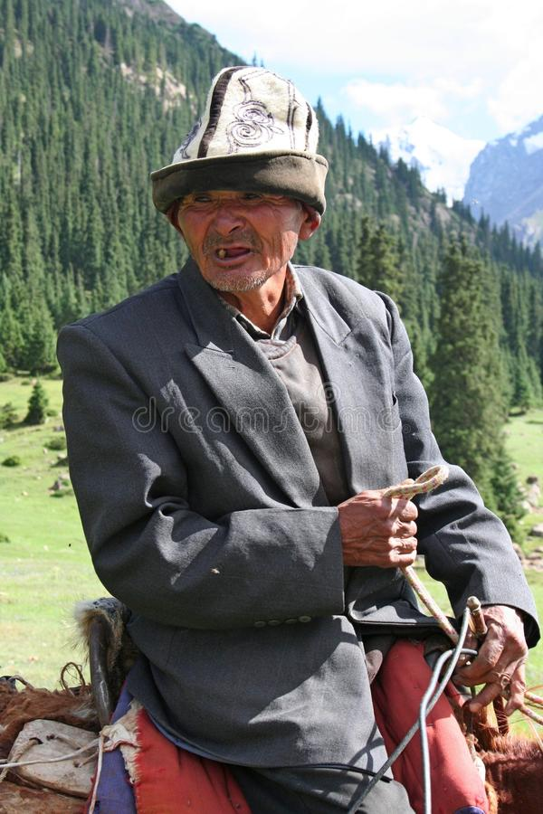 Kyrgyz horseman in Tien Shan mountains. Central tien shan region, Dzhuku valley royalty free stock photos