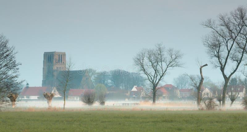 Kyrka av den Damme byn i Belgien royaltyfria foton