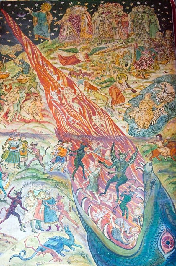 Kyrklig freskomålning - himmel och helvete. royaltyfri foto