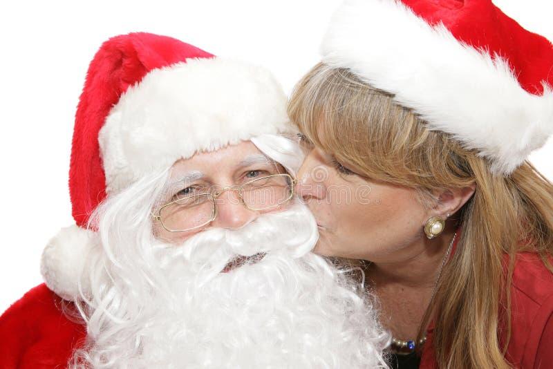 Kyssa för Santa royaltyfri fotografi