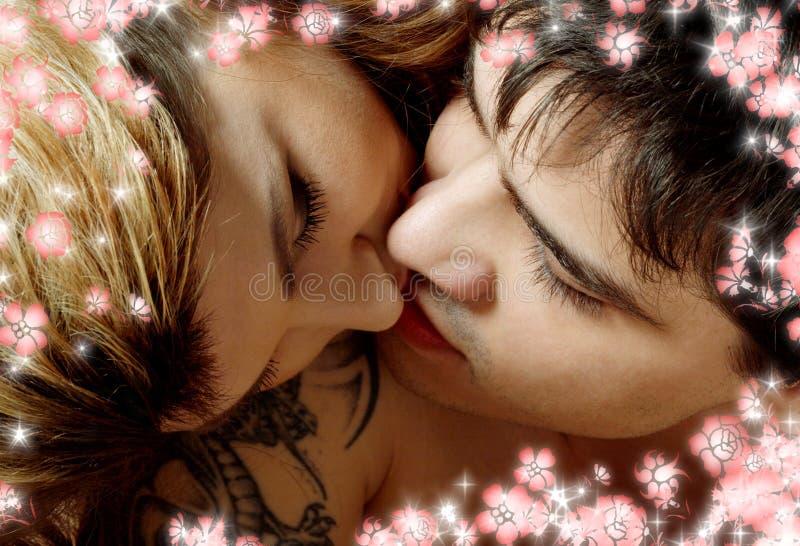 kyssa för underlagblommor arkivbild