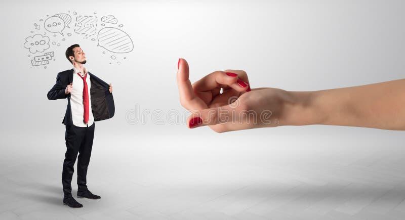 Kysst aff?rsman med att agna handbegrepp royaltyfri foto