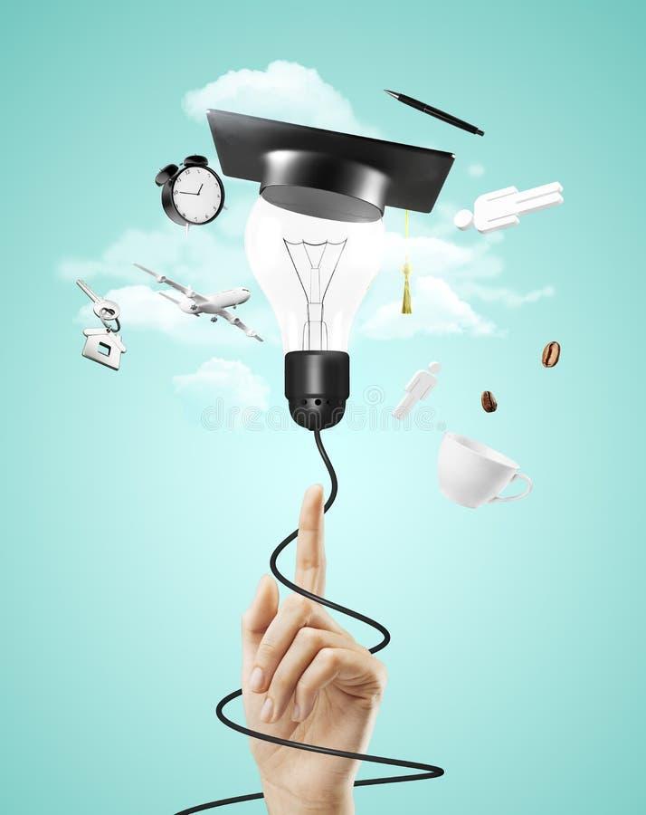 Lámpara con el sombrero de la graduación fotografía de archivo