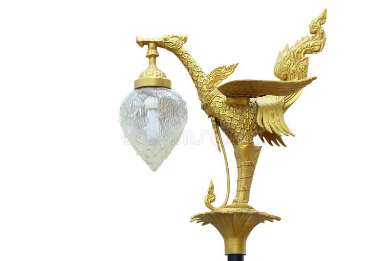 Lámpara de oro de las estatuas del cisne aislada en blanco imagenes de archivo