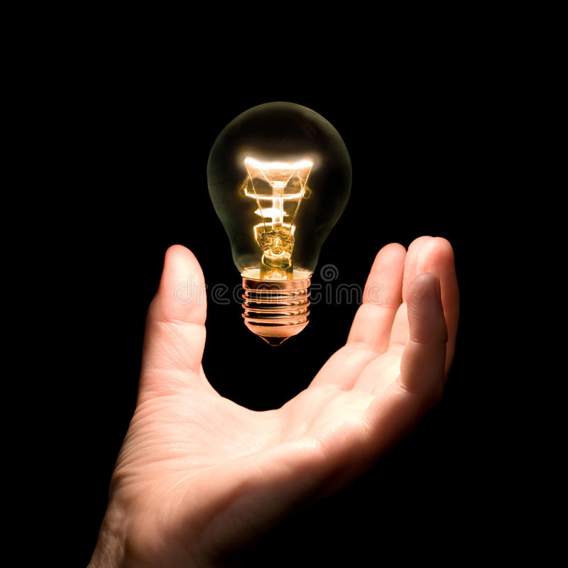Lámpara del bulbo disponible foto de archivo