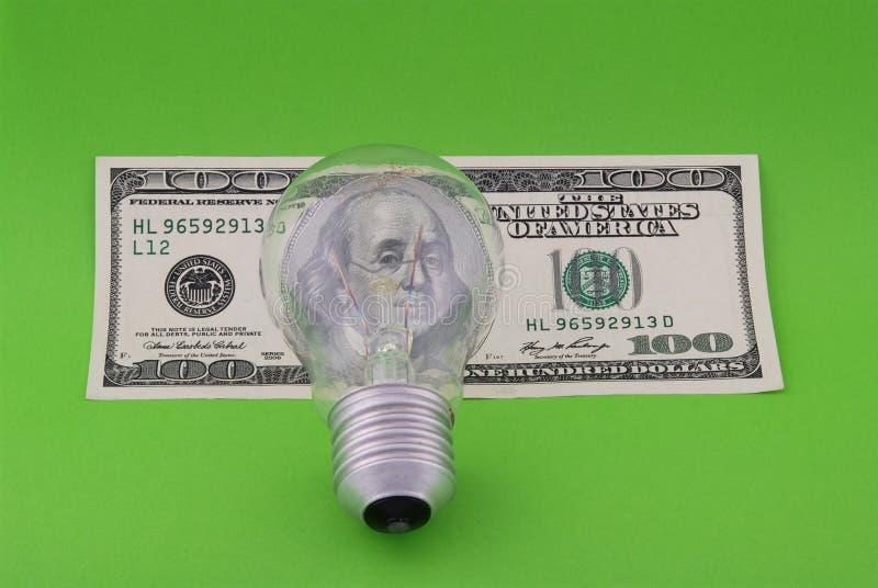 Lámpara eléctrica en cientos dólares foto de archivo libre de regalías