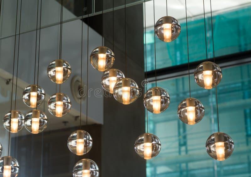 Lámparas de cristal del pequeño diseñador redondo fotografía de archivo