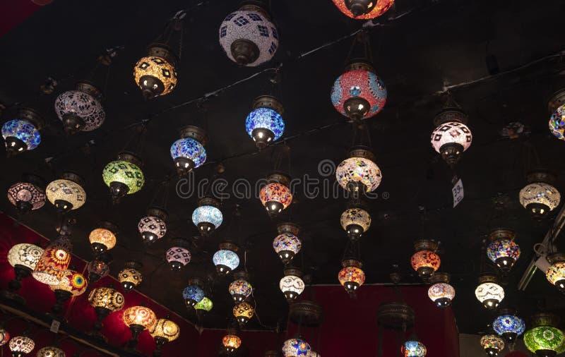 Lámparas regionales modeladas colgadas en la pared fotografía de archivo