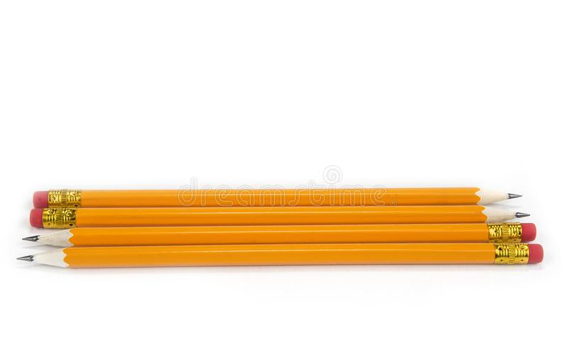 Lápices amarillos con el borrador en el fondo blanco, imagenes de archivo