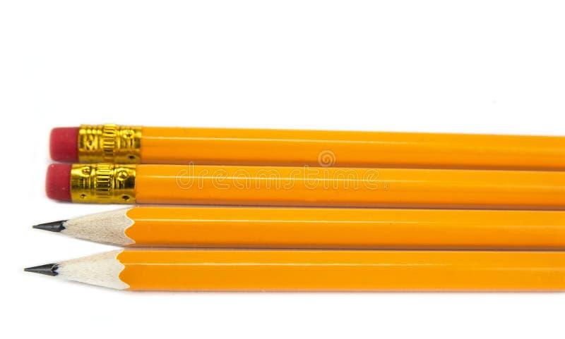 Lápices amarillos con el borrador en el fondo blanco, imagen de archivo