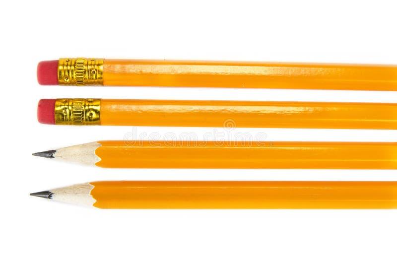 Lápices amarillos con el borrador en el fondo blanco, fotografía de archivo libre de regalías