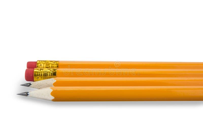 Lápices amarillos con el borrador en el fondo blanco imagen de archivo